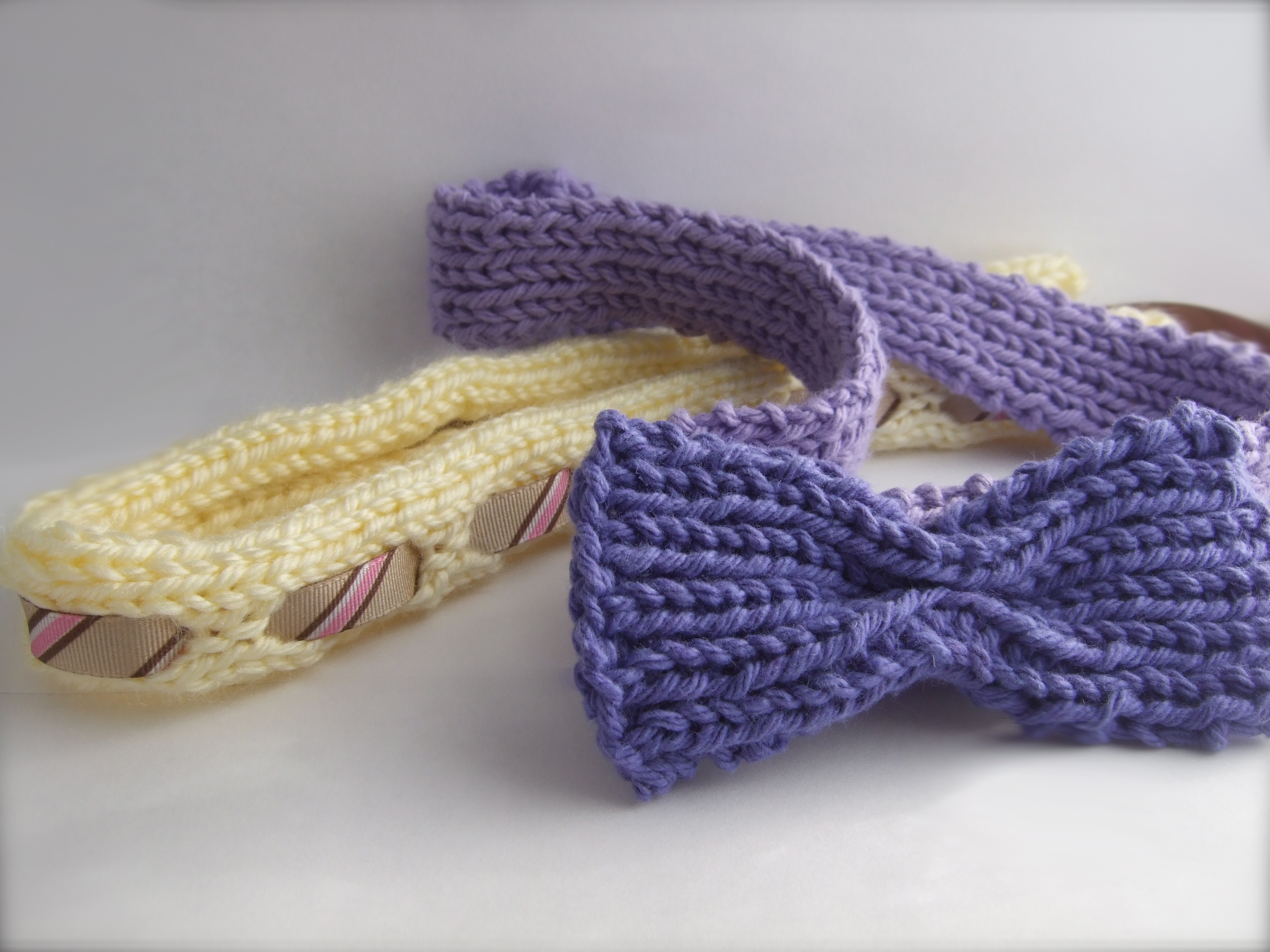 2 knit headbands- yellow and purple