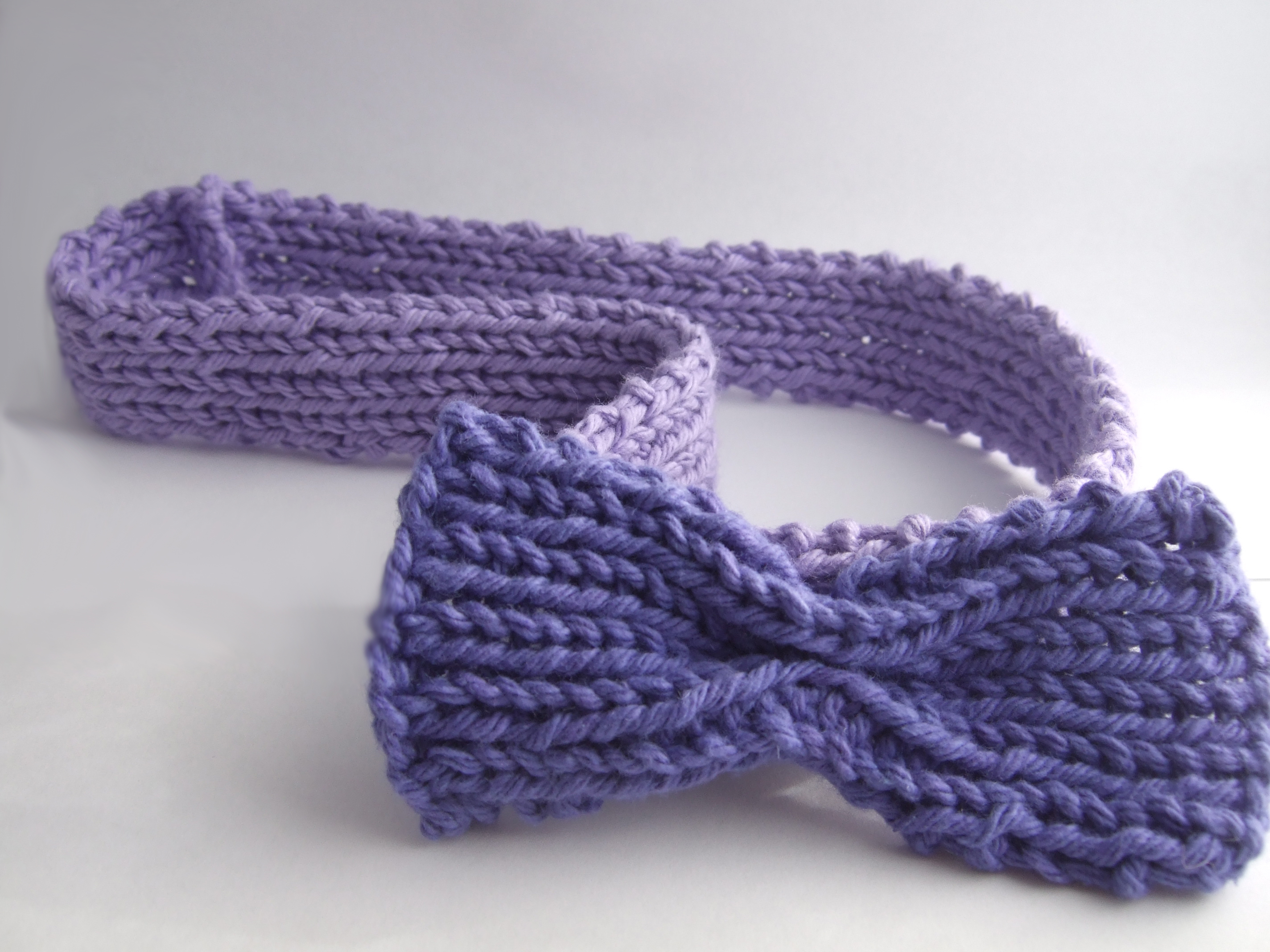 purple knit headband with bow